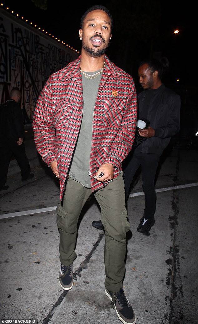 Handsome:Michael, meanwhile, showed off his quirky sense of style as he paired a red plaid jacket over a grey shirt and matching cargo trousers