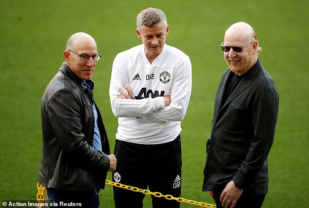 Joel (left) and Avram (right) Glazer are pictured with boss Ole Gunnar Solskjaer in April 2019