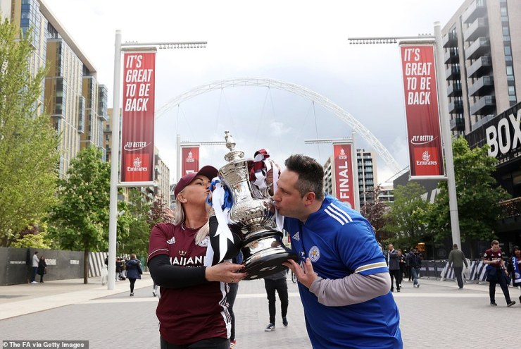 Two Leicester fans pose with something a little closer to the real thing as they make their way into the stadium