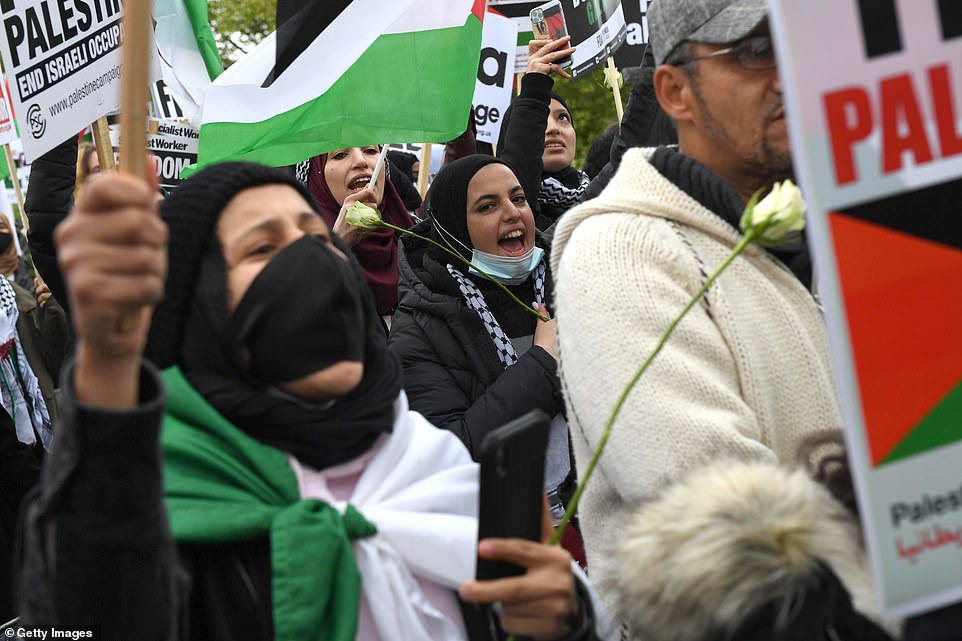 Protesters held white roses and draped themselves in the Palestinian flag as they marched on Saturday