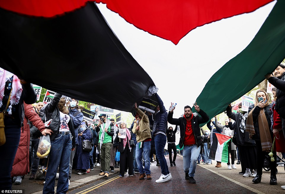 Pro-Palestinian demonstrators attend a protest in London following a flare-up of Israeli-Palestinian violence