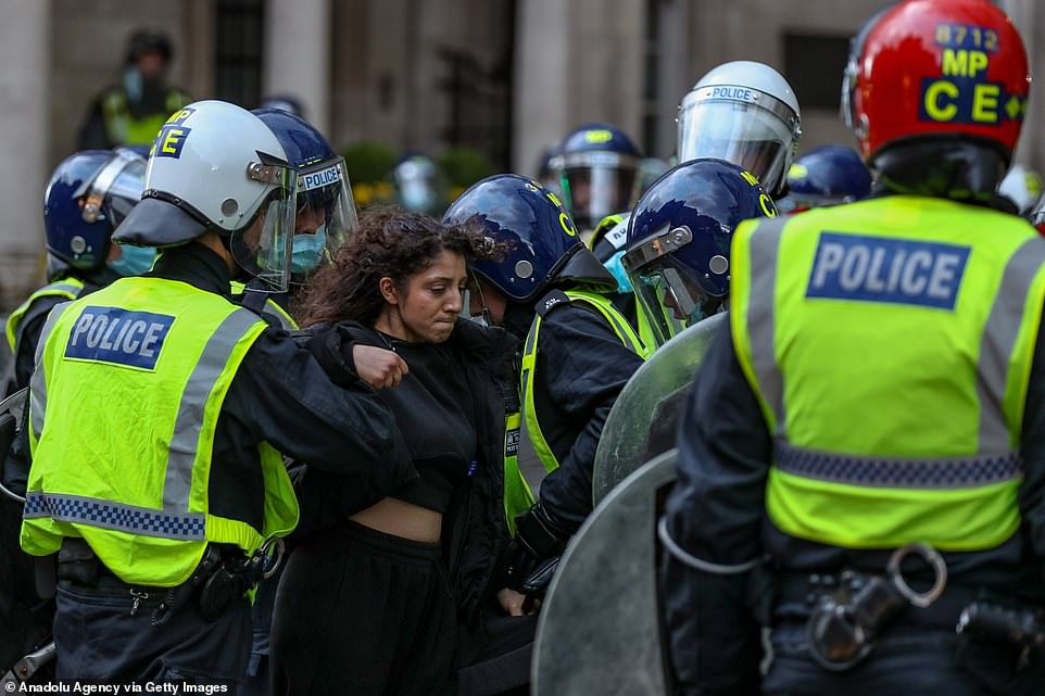 Nine people were arrested on suspicion of violent disorder in London, the Metropolitan Police said. Pictured:Metropolitan Police arrest a pro-Palestinian demonstrator outside the Israeli Embassy in central London on Saturday, May 15, 2021