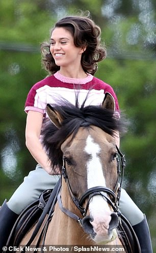 Joy: The London native smiled broadly as she rode the horse before rolling cameras