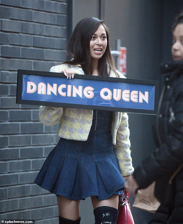 Birthday girl: The Russian dancer was spotted on the streets of Soho as she posed with a red purse and a 'Dancing Queen' sign