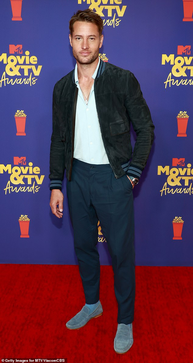 Casual: The This Is Us star kept it relatively casual in the fashion department with dark blue pants with a black suede jacket over a white dress shirt and gray slip-ons