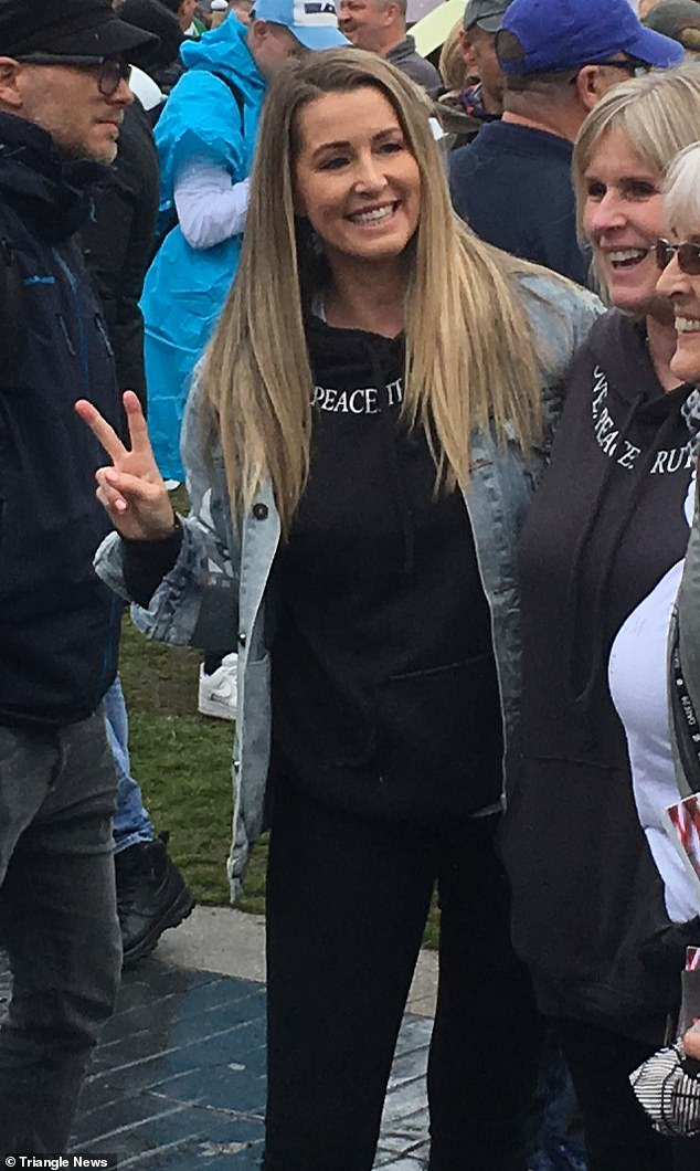 Anti-lockdown protest: Real Housewives of Cheshire TV star Leanne Brown was spotted among the protesters at an anti-lockdown rally in Manchester on Sunday