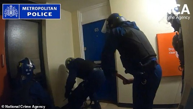 Still taken from footage of police raiding the drug gang. Evidence showed that they plotted to continue their operation during the first and strictest UK lockdown
