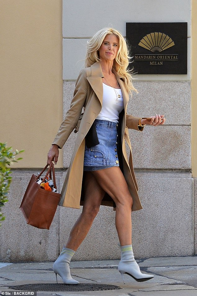Chic: Victoria Silvstedt, 46, put on a leggy display in a short skirt as she strutted her stuff through the streets of Milan on Monday