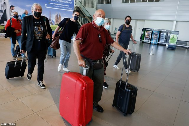 People arrive at Faro Airport from Manchester on the first day that Britons are allowed to enter Portugal without needing to quarantine