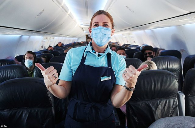 Staff and passengers onboard an early morning TUI flight to Madeira, one of the few green list destinations where people visiting from England will now not need to quarantine on their return. Issue date: Monday May 17