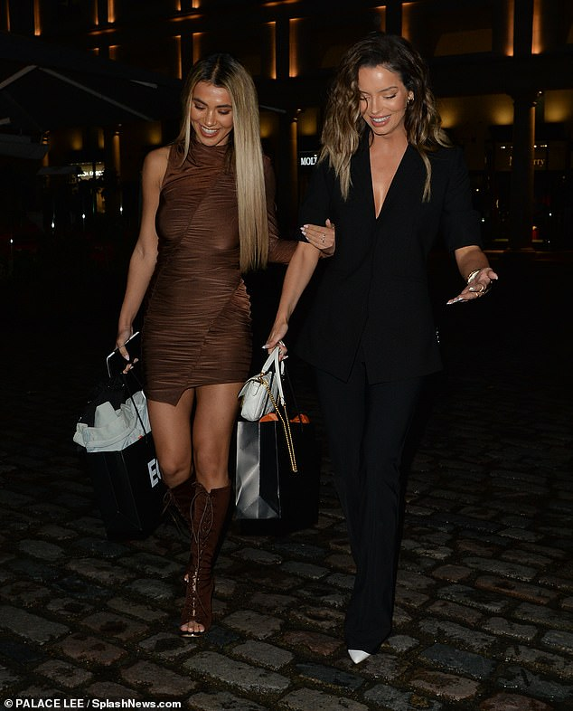 Big turnout: Maura and Joanna laughed together as they took on the cobblestone streets with their high heels on
