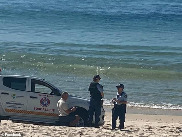 New South Wales Ambulance said he has an upper leg injury after the attack at Tuncurry Beach Pictured: Police and Surf Lifesavers at Tuncurry Beach after the attack