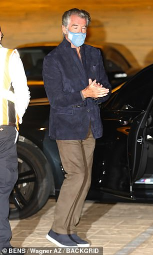 Dapper: Pierce made up his ensemble by wearing brown pants, while he completed his look by stepping out in blue slip-ons