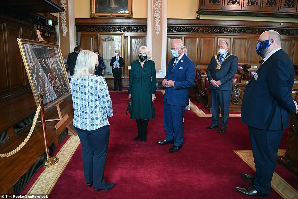 The Prince of Wales, 72, and Duchess of Cornwall, 73, chatted with staff as they learned about the rich and varied history of the city