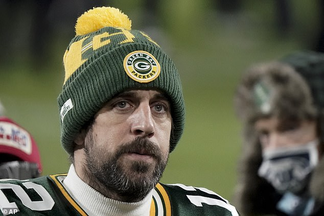 Looking Ahead: The veteran signalman was on the Hawaiian getaway amid uncertainty over his future on the Green Bay Packers.  He was broken earlier this year