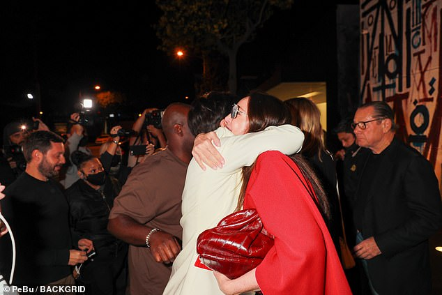 Hugs all round: The Kardashian's 'momager' was surrounded by fans and cameras