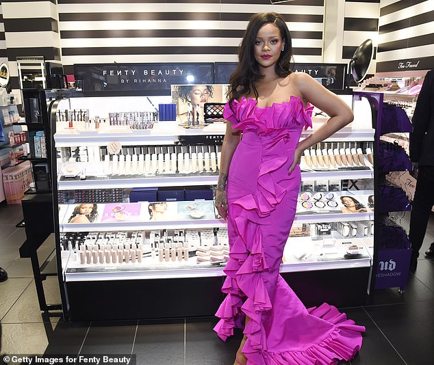 Millionaire: Rihanna's UK fashion firm is now worth £27 million, despite the clothing line being put 'on hold' last week to focus on her beauty and lingerie ranges (pictured 2018)