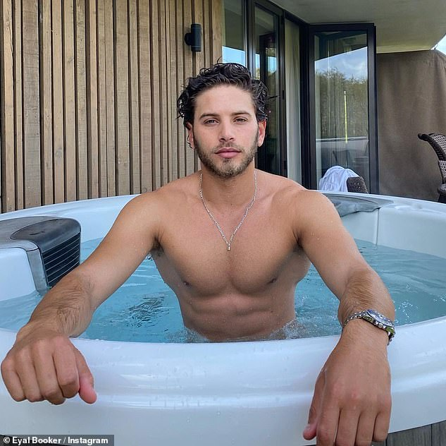 Looking good:In the snaps, Eyal could be seen showing off his muscular figure as he enjoyed a dip in a hot tub on their terrace