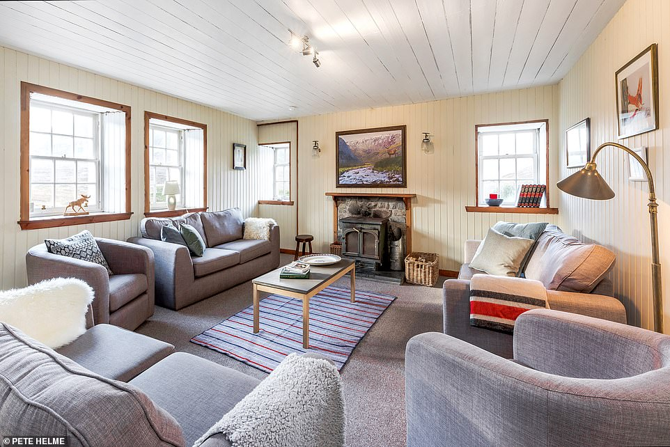 This picture shows Deanich Lodge's open-plan living room and woodburning stove