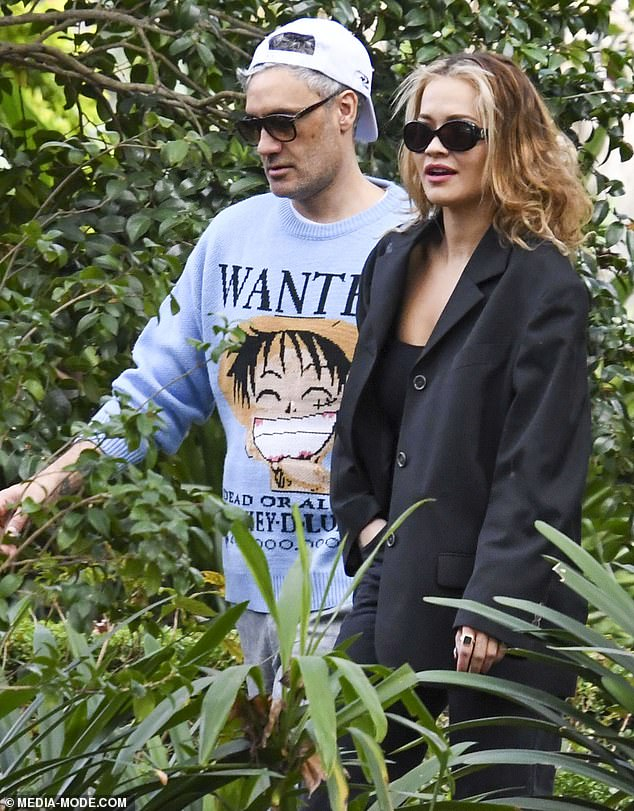Out and about: Rita Ora and her new boyfriend Taika Waititi (both pictured) look loved-up as they enjoyed lunch at Chiswick restaurant in Sydney's Woollahra on Thursday