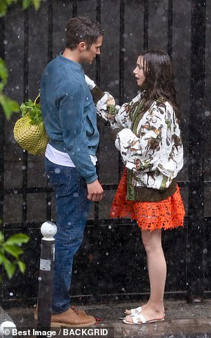 Chic: Lily looked effortlessly chic for the day of filming in a plunging orange embroidered lace mini dress