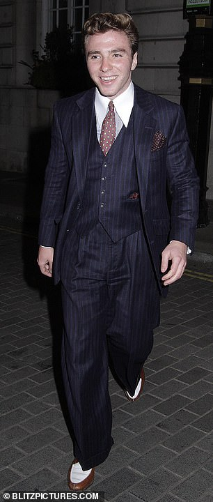 Outing: Rocco Ritchie followed in his father Guy's fashion footsteps as he donned a blue three-piece suit for dinner with friends in London on Wednesday