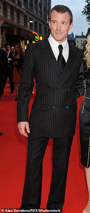 Sharp: Guy pictured in a pinstripe suit in 2008