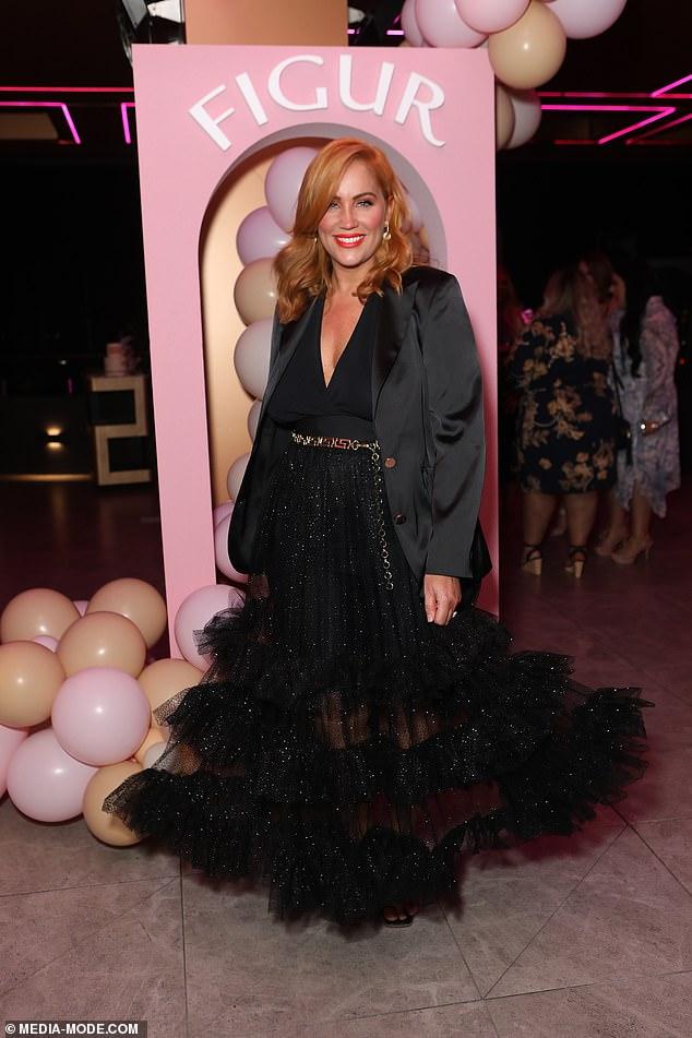 Elegant: Jules Robinson oozed elegance as she posed at celebrations for her shapewear brand Figur in Sydney on Thursday