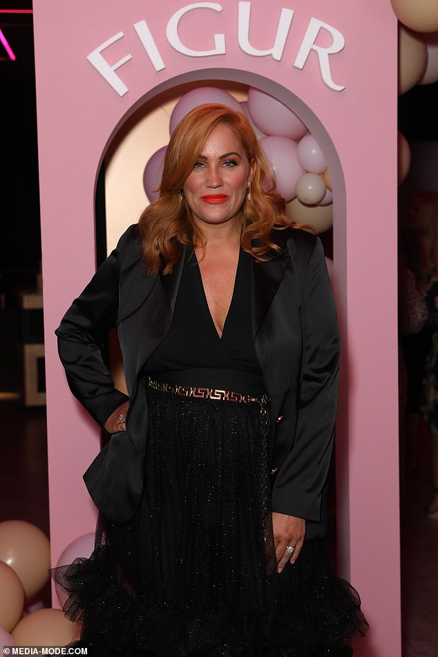 Glamazon: The beauty proved her fashion credentials yet again in the gown which she paired with a silk-look black blazer and chain belt