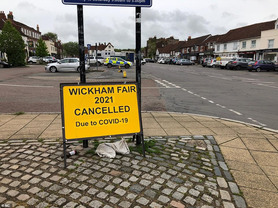 Signs around the town warn people that the event has been cancelled amid the pandemic to prevent further people turning up