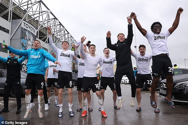 Derby players celebrated their survival in the Championship outside the ground with fans