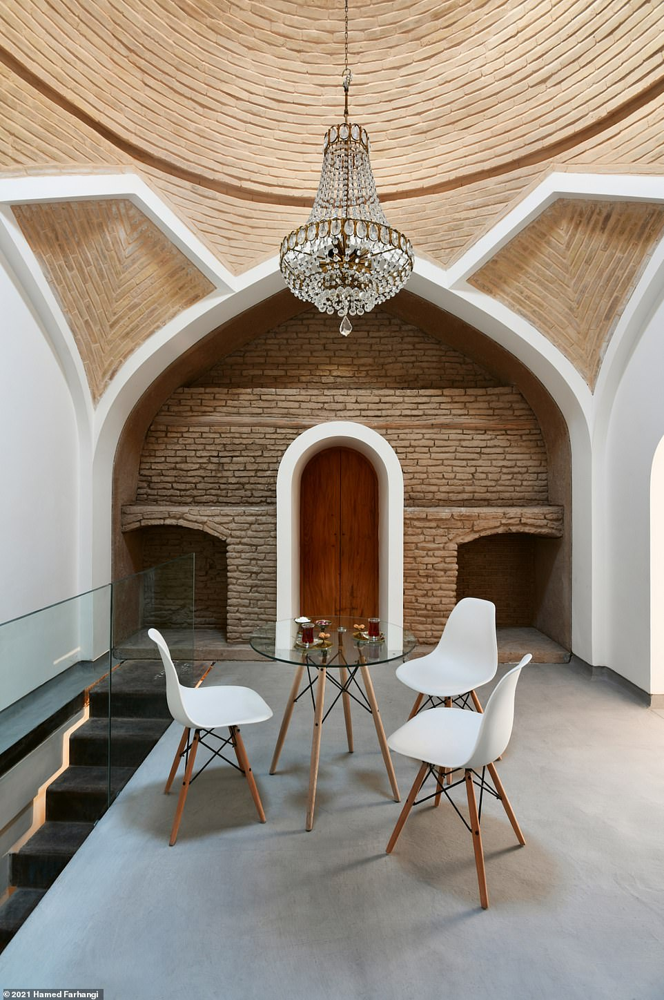 In Persian Nights Wegmann explains how the Joybar boutique hotel (pictured) in the city of Esfahan in central Iran 'rose from the run-down remnants of a residence from the late Qajar Dynasty'. He goes on to say: 'Joybar Boutique Hotel was a passion project of the young architect Tahereh Mokhtarpour and her partner, Manouchehr Peyvand Heydari, both of whom moved to Esfahan to realise the renovation and consequent boutique hotel project'