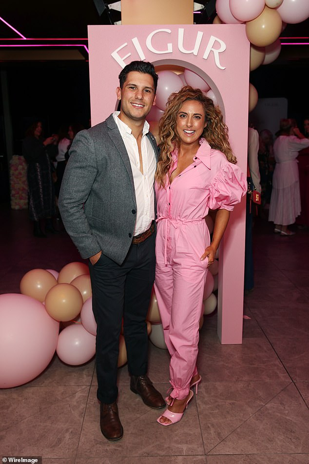 Still going strong: Married At First Sight's Johnny Balbuziente and Kerry Knight, both 30, are all smiles as they step out to support Jules Robinson in Sydney