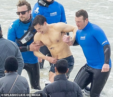 A bit cold? Harry Styles offered a glimpse of his shirtless physique during filming for My Policeman on Thursday