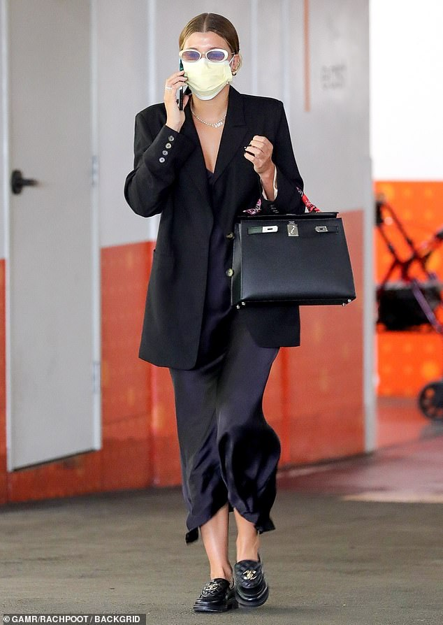 Professional:Sofia Richie was the picture of elegance as she stepped out in a chic ensemble in Beverly Hills. The 22-year-old model looked ready for business as she prepared to leave an underground parking lot on Thursday