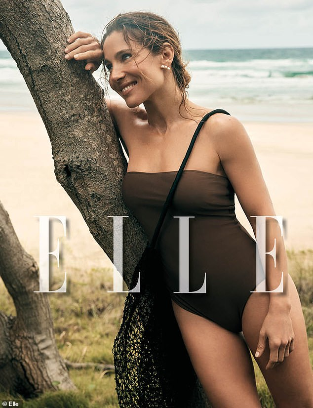 Glamorous:In another photo, Elsa showed off her incredible figure in a brown swimsuit as she leaned on a tree