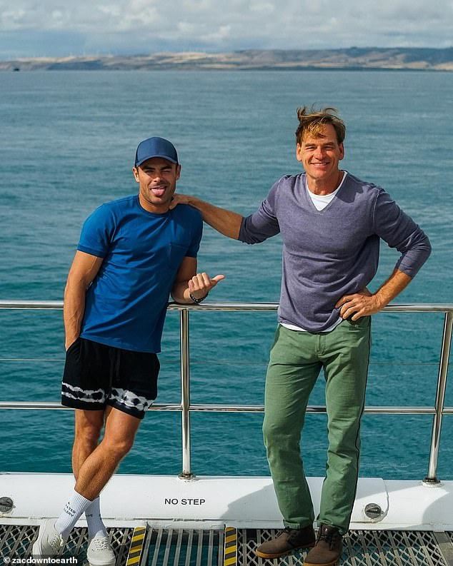 Travel show:Zac is exploring some of Australia's most iconic tourist attractions for his new Netflix series Down to Earth, which he is co-hosting with wellness expert Darin Olien (right)