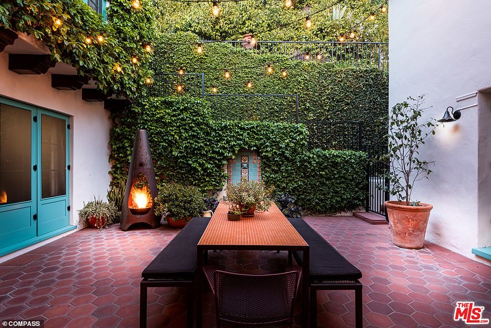 Making bank: 45-year-old Modern Family star Jesse Tyler Ferguson and his husband Justin Mikita had previously set the original asking price for the mansion at $6.995 million in March, according to Dirt. It's a substantial profit for Ferguson, who only paid $4.6 million when he originally bought it in 2013. Pictured: DiCaprio's new home includes a tiled court dining terrace with an ivy-covered wall and stairs that would be ideal for entertaining or just enjoying dinner outdoors.