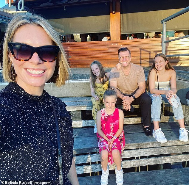Just friendly conversation:When Richard asked whether Alex was 'hitting on her', Belinda stressed that it was simply a bit of fun banter and that she's happily married with three children. 'Surely not [hitting on me]. He just likes my videos.... I'm very happily married'. Pictured with Mark Calvert and their children