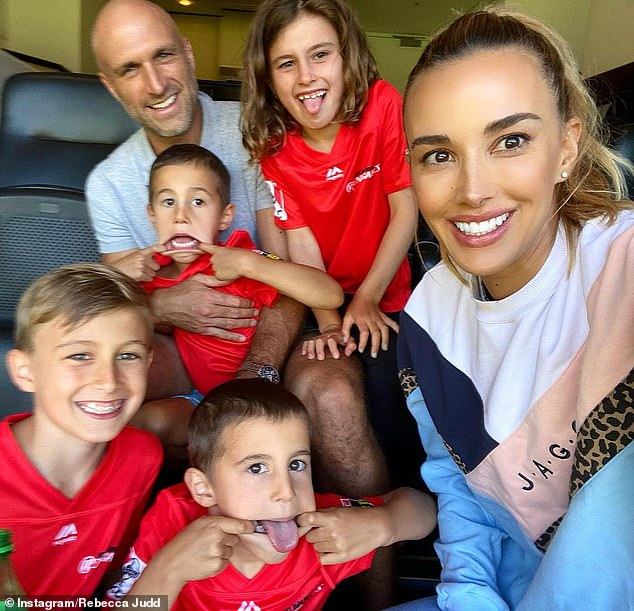 Family: The former Postcards host is self-isolating during Melbourne's latest Covid lockdown in her $7.3million mansion in Brighton. Pictured with her husband and children