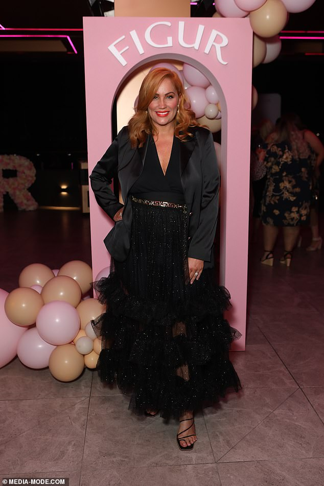 Ruffled up: Meanwhile star of the night, Jules Robinson wore an elaborate floor-length black tulle gown with glitter and ruffle tiers