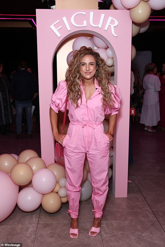 Stylish! Kerry looked stylish in a pink jumpsuit, which she paired with matching pink heels, and her caramel-coloured hair was styled in loose curls