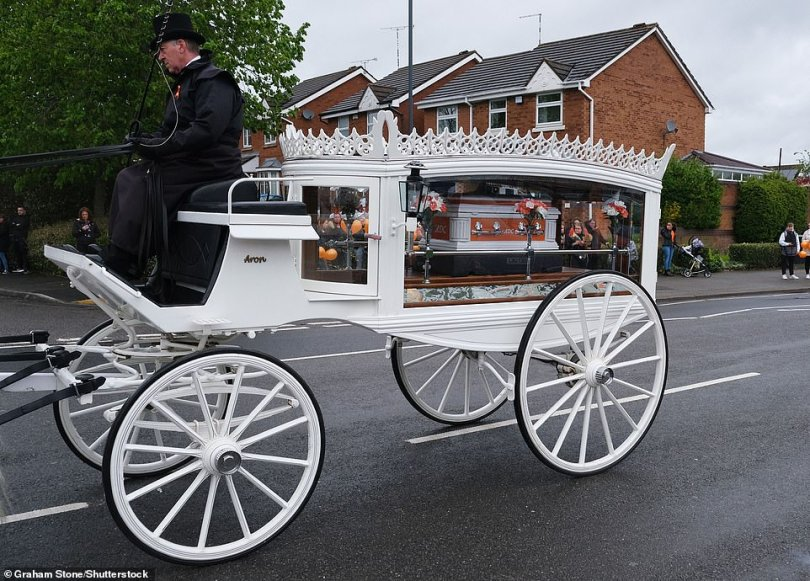 Farewell: Crowds lined the streets in Nuneaton as the eight-month-old was given a beautiful send off in a white horse drawn carriage