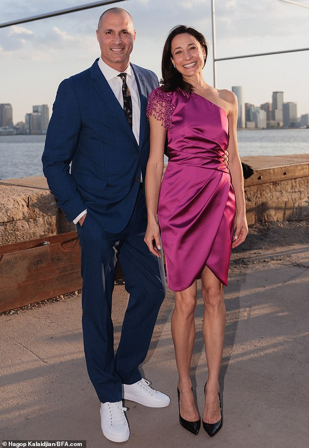 While attendees like Nigel Barker and his wife Cristen took in live music and speeches they basked in the beauty of the setting designed by celebrity party planner David Stark