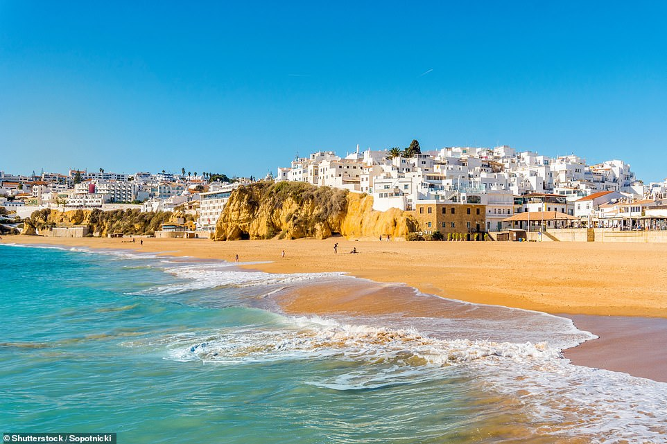 The stunning sandy beach in the resort of Albufeira.Prices of flights to Portugal are enticing as airlines schedule more planes to the country