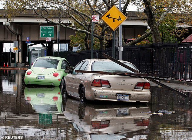 Hurricanes that make landfall now are taking longer to weaken—an average of 33 hours— compared to just 17 hours some 50 years ago. Pictured:Parked cars are partially submerged in flood waters in the aftermath of Hurricane Sandy in New York in 2012