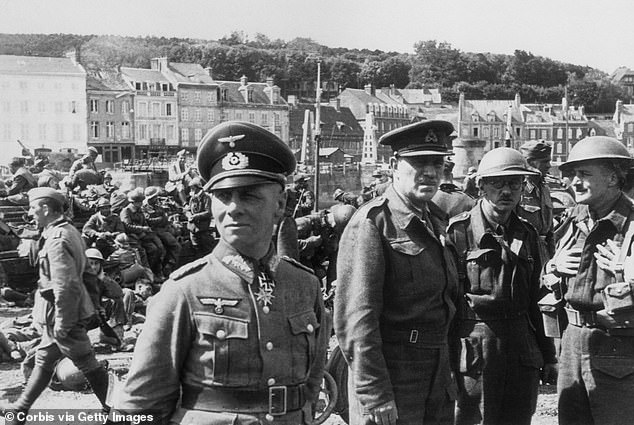 They arrived at a castle on the River Seine which the German commander, Field Marshal Erwin Rommel, had requisitioned for his headquarters. (Pictured foreground,General Erwin Rommelduring the Nazis' North African campaign during World War II, circa 1941)