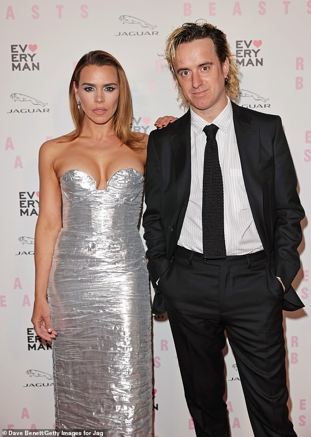 Dazzling:Billie Piper shined bright in a shimmering silver dress on Friday as she attended the Rare Beasts gala screening with her partner Johnny Lloyd in London