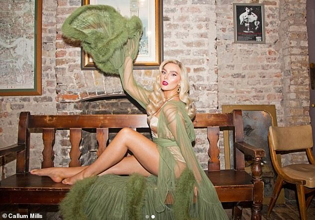 Stunning:Little Mix's Perrie Edwards was sure to amp up the glamour as she donned nude lingerie and a green robe in a stunning behind-the-scenes snap from the shoot