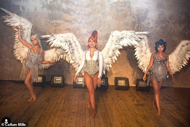 Here they come: The band commanded attention in their stunning 'winged fatales' costumes
